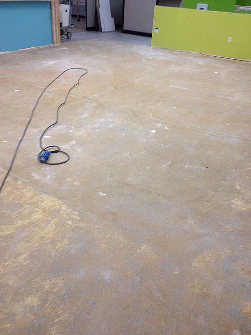 Concrete Floors with glue from previous carpet