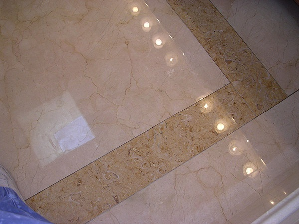 Limestone and Crema Marfil marble bathroom